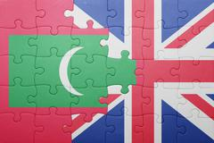 puzzle with the national flag of great britain and maldives - stock photo