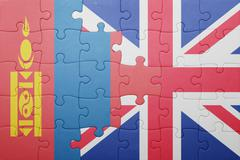 Puzzle with the national flag of great britain and mongolia Stock Photos