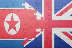 puzzle with the national flag of great britain and north korea - stock photo