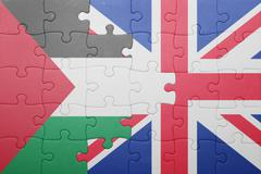 puzzle with the national flag of great britain and palestine - stock photo