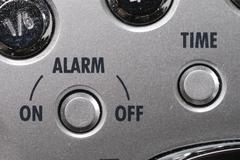 Alarm button of a clock radio Stock Photos