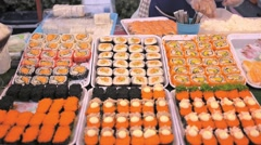 Japanese Food - Sushi and Sashimi on Street Market - stock footage