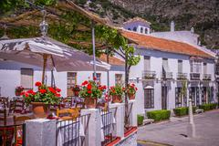 Stock Photo of Picturesque street of Mijas. Charming white village in Andalusia, Costa del S