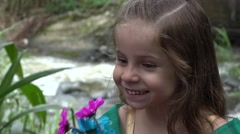 Stock Video Footage of Happer Girl with Flowers by River