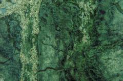 Green Marble Granite Stone slab surface - stock photo