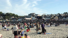 BINIC, FRANCE People on beach at Binic Folks Blues Festival, 4K - stock footage