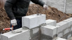Bricklayer mortar to build the wall - stock footage