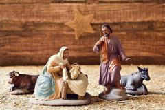 the holy family in a rustic nativity scene - stock photo