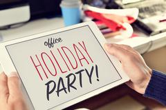 text office holiday party on a tablet - stock photo