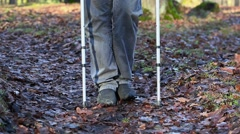 Disabled man on crutches at outdoor on the path Stock Footage