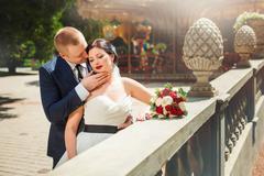 Wedding couple near carousel - stock photo