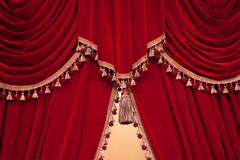 Red theater curtain with tassels Stock Photos