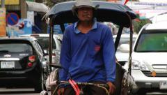 Rickshaw rides by the street of Surin, Thailand. - stock footage