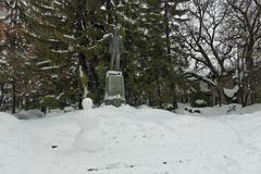 Statue of  bulgarian poet Nikola Vaptsarov in the ancient Bansko town - stock photo