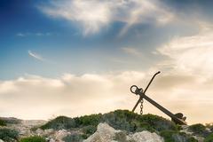 Beautiful anchor in Paros island against a dramatic sky. Stock Photos
