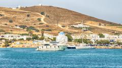 Antiparos port in Greece with a traditional white church standing in the middle. Stock Photos