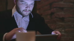 Man Using Tablet PC in the evening Close-Up. Shot on RAW Stock Footage
