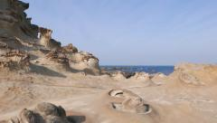 Otherworldly rocky landscape of Yehliu Geopark Cape Stock Footage