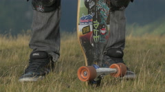 Great view of one longboarder standing on Transalpina Stock Footage