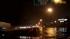 Stock Video Footage of POV dashcam driving on Ontario 400 series highways at night in rain