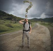 Lost explorer in mountain path - stock photo