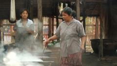 People boil threads for traditional weaving in Surin, Thailand. - stock footage