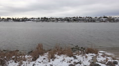 Timelapse winter cloudy lake alient aerial drone visitor spotted. Stock Footage