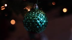 Green Christmas ball on dark background Stock Footage