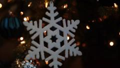 Christmas tree decoration, snowflake, dark background - stock footage