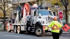 Road worker regulating traffic Stock Footage