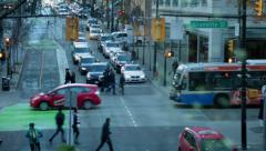 Red taxi car moving, downtown Vancouver Stock Footage