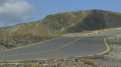 Beautiful view of four longboarders riding slow on Transalpina Stock Footage