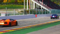 Various Italian cars driving at the Spa Francorchamps race track Stock Footage