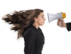 Businesswoman frightened by reproach - stock photo