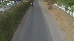 A  view  of athletes running along the promenade of the river Entella Stock Footage