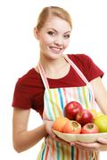 Housewife or seller offering healthy fruit isolated Stock Photos