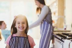 Stock Photo of Portrait enthusiastic girl with toothy smile in kitchen