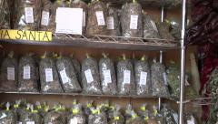Many various herbs and other spices in city market Stock Footage