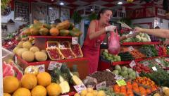 Spanish city market bazaar with fruits, vegetables, mushrooms and peoples Stock Footage