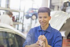 Portrait confident mechanic in auto repair shop Stock Photos