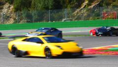Ferrari Lamborghini track day Stock Footage