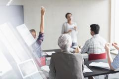 Teacher and students in adult education classroom - stock photo