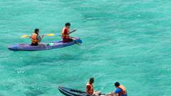 Young people having fun at sea kayaking nature at Samaesarn Island Stock Footage