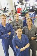 Stock Photo of Portrait smiling mechanics in auto repair shop