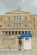 Evzone standing in position guarding the parliament of Greece. - stock photo