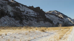 Herd of Bighorns in Sunlit Winter Mountains - Wide Stock Footage