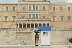 Evzone standing in position guarding the parliament of Greece. Stock Photos
