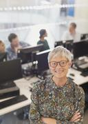 Portrait confident senior woman in adult education computer classroom - stock photo