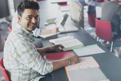 Portrait confident student in adult education classroom - stock photo