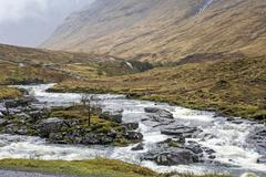 Winding river through highlands landscape, Glen Etive, Argyll, Scotland - stock photo